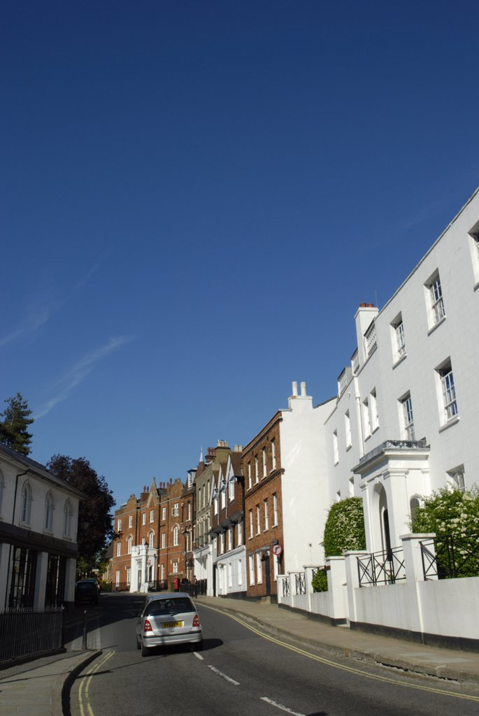 Stock Photo: 4282-23795 England, London, Harrow on the Hill. A blue sky over the buildings of Harrow on the Hill in London.