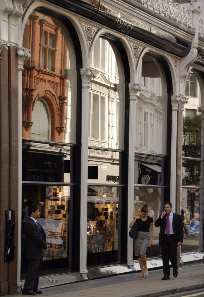 Stock Photo: 4282-23956 England, London, Bond Street. Reflections in the shop front of Asprey jewellers on New Bond Street.
