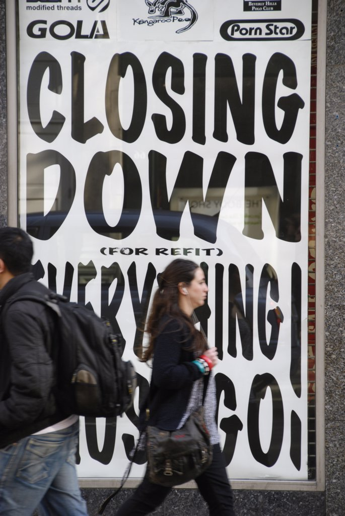Stock Photo: 4282-24201 England, London, Oxford Circus. Shoppers passing a store advertising a closing down sale in Oxford Street.