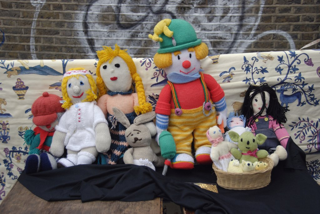 England, London, Brick Lane. A collection of colourful knitted dolls on a market stall in Brick Lane. : Stock Photo
