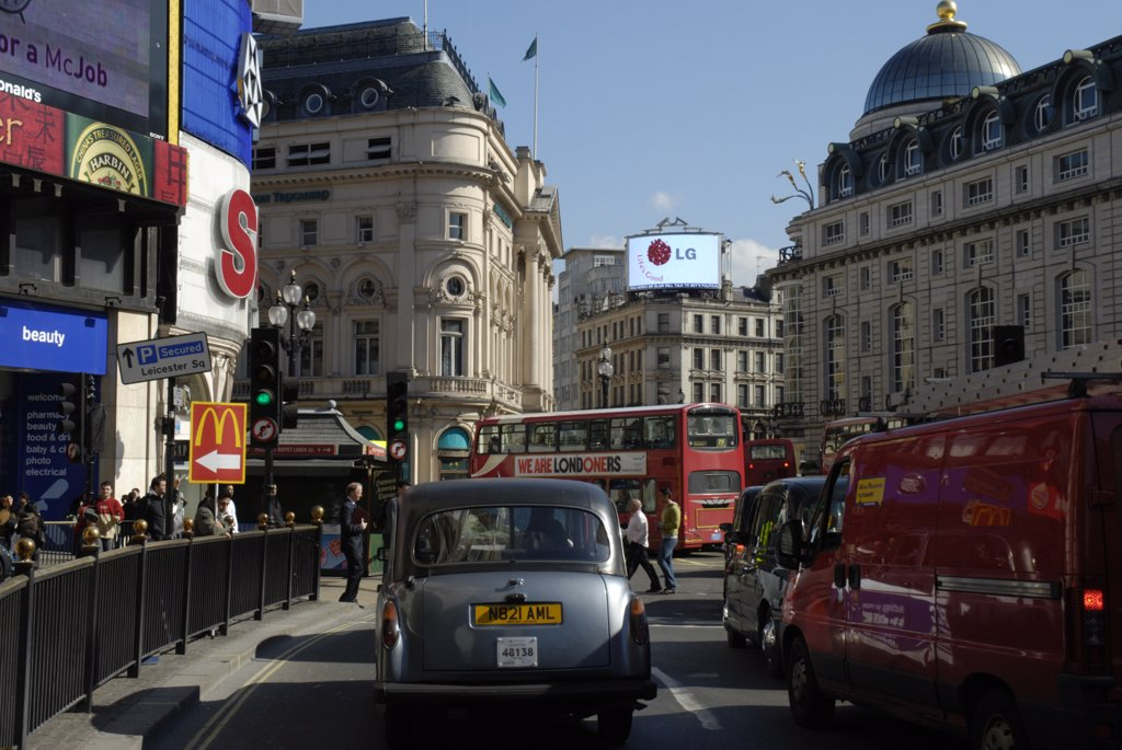 England, London, Piccadilly Circus. Traffic passing through Piccadilly Circus. : Stock Photo