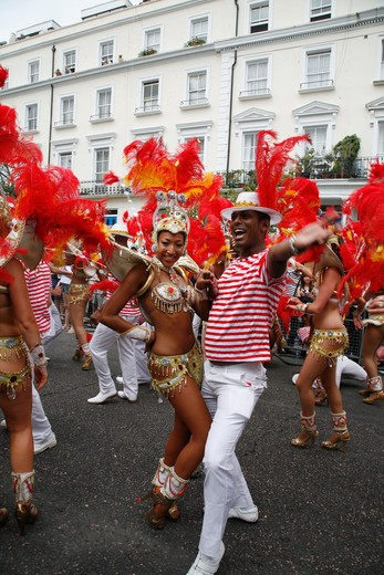 England, London, Notting Hill. Costume parade at Notting Hill Carnival on Westbourne Grove. : Stock Photo