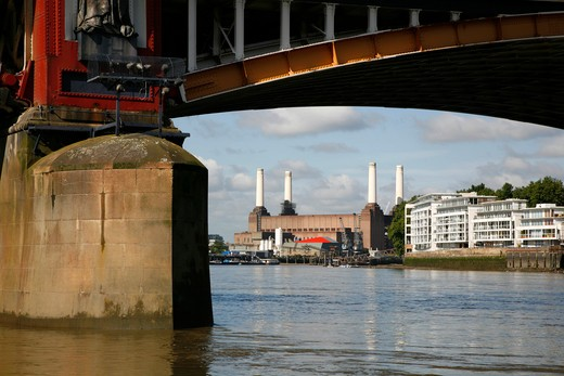 Stock Photo: 4282-24466 England, London, Vauxhall. View along the River Thames to Battersea Power Station seen from under one of the arches of Vauxhall Bridge.