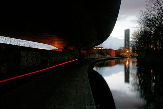 Stock Photo: 4282-24472 England, London, Westbourne Green. View along the Grand Union Canal to the Trellick Tower from under the shadow of Westway.