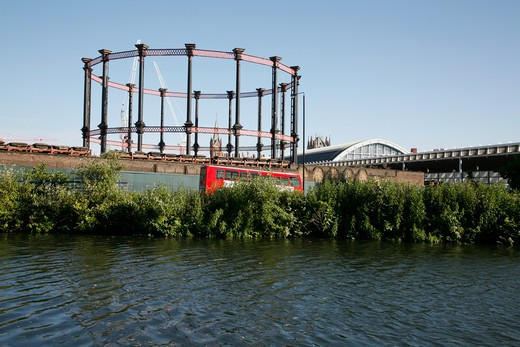 England, London, Regent's Canal. View across the Regent's Canal to the old gasholders at King's Cross. : Stock Photo