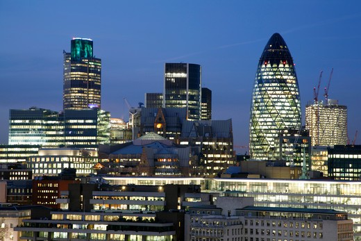 England, London, City of London. A view at night toward Tower 42 and The Gherkin in the City of London. : Stock Photo