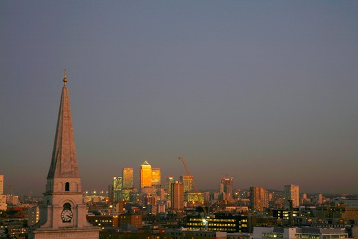 England, London, Canary Wharf. View past Christ Church in Spitalfieds to Canary Wharf at sunset. : Stock Photo