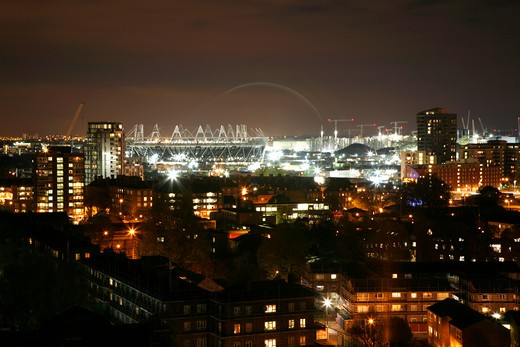 England, London, Bromley By Bow. Roofline view of the Olympic Stadium in the Olympic Park in Stratford taken from Bromley by Bow. : Stock Photo