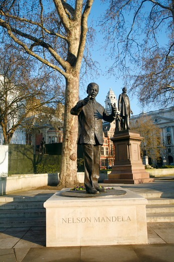 England, London, Westminster. Statues of Nelson Mandela and Robert Peel on Parliament Square in Westminster. : Stock Photo