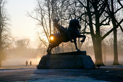 England, London, Kensington Gardens. Frost and mist shrouded Physical Energy statue in Kensington Gardens. : Stock Photo