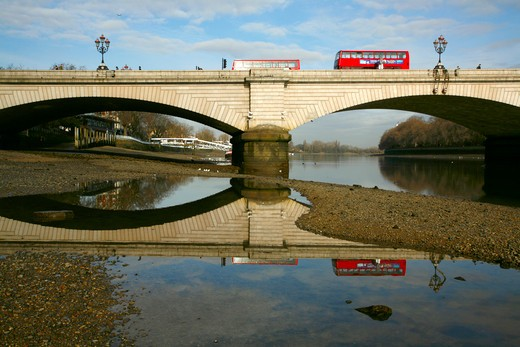 England, London, Putney. Putney Bridge reflected in a tide pool on the River Thames at low tide. : Stock Photo