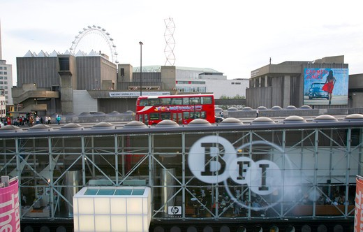England, London, South Bank. A London bus drives over the BFI under Waterloo Bridge on the South Bank. : Stock Photo