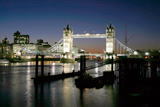 England, London, Tower Bridge. Looking up the River Thames to Tower Bridge at night. : Stock Photo
