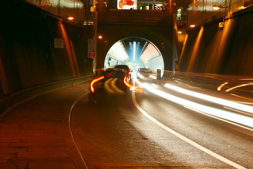 England, London, Rotherhithe Tunnel. Light trails at the entrance to the Rotherhithe Tunnel at Limehouse. : Stock Photo