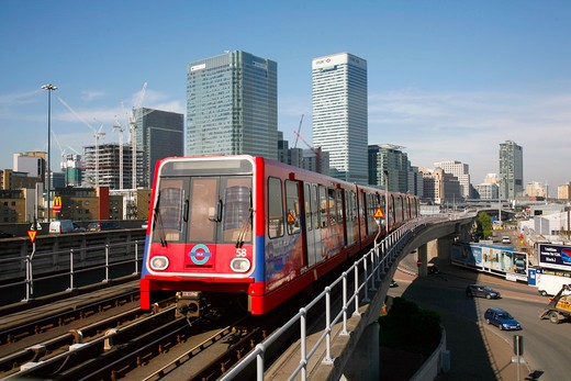 England, London, Canary Wharf. A Docklands Light Railway train moving away from Canary Wharf. : Stock Photo
