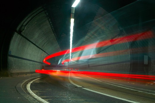 England, London, Rotherhithe Tunnel. Light trails from cars driving under the River Thames through Rotherhithe Tunnel. : Stock Photo