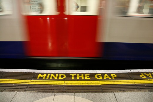 Stock Photo: 4282-24914 England, London, Waterloo Underground Station. Mind The Gap written on the Bakerloo Line platform at Waterloo Underground Station.
