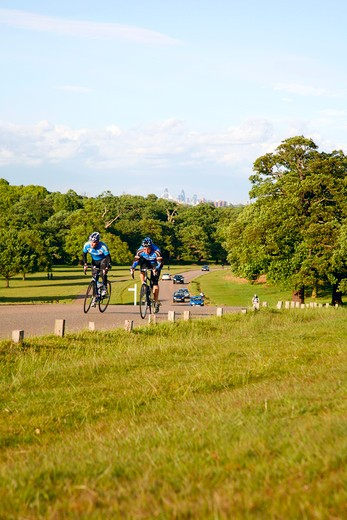 Stock Photo: 4282-24963 England, London, Richmond Park. Cyclists in Richmond Park.