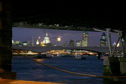 England, London, City of London. Full moon rising over the City of London. : Stock Photo