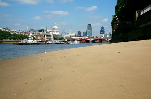 England, London, King's Reach. A view of St Paul's Cathedral and the City of London from the River Thames beach at King's Reach. : Stock Photo