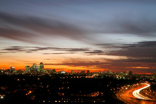Stock Photo: 4282-25015 England, London, Beckton. Dusk falling over a panoramic view of the East End, Canary Wharf and the City of London in the far distance.