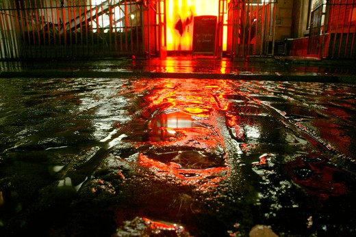 England, London, Covent Garden. Neon light reflected in the wet cobbles of Covent Garden Piazza. : Stock Photo