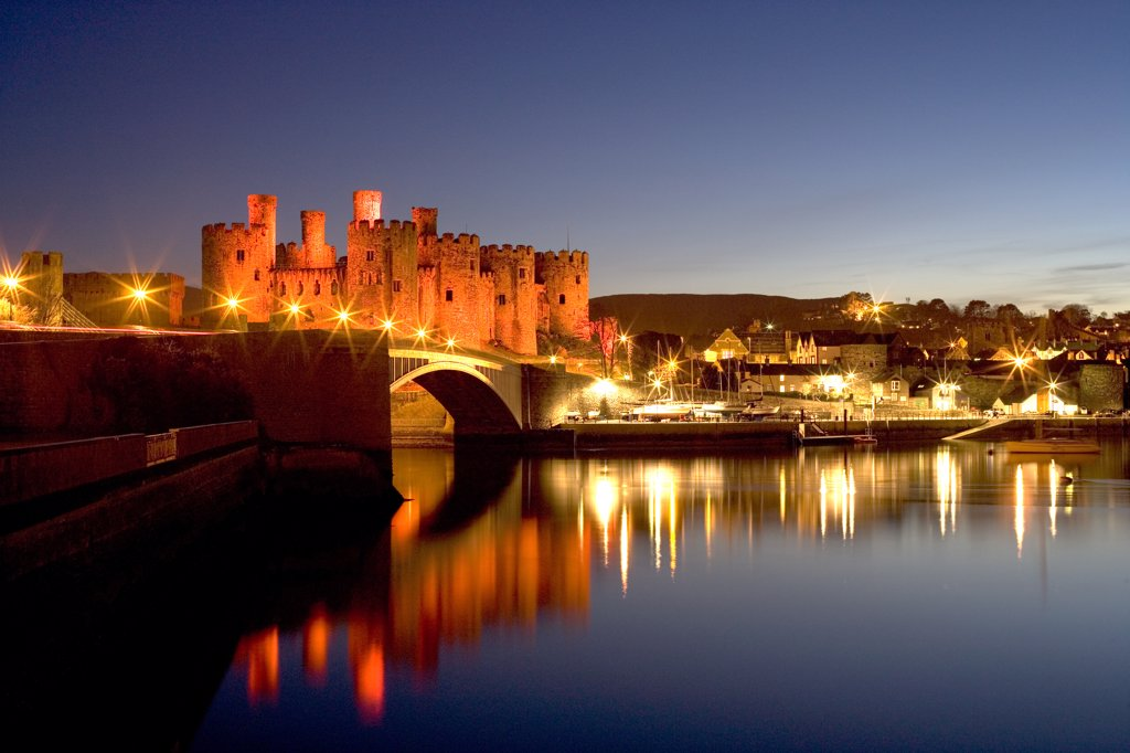 Stock Photo: 4282-25094 Wales, Clwyd, Conwy Castle. A view of Conwy Castle at dusk from over the River Conwy.