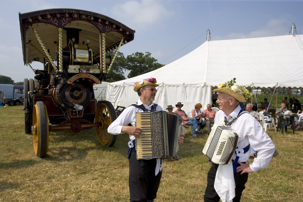 England, Hertfordshire, Whitwell. The Offley Morris Men and a Burrell Showman's Locomotive at the Whitwell Steam and Country Fair. : Stock Photo