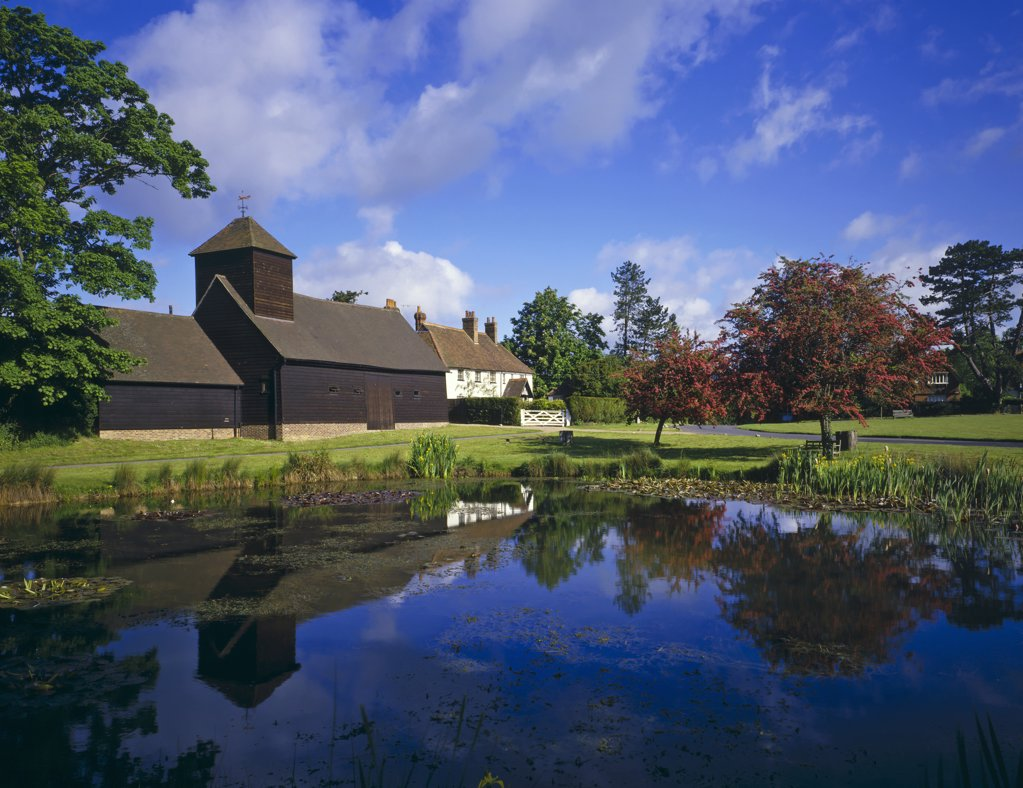 Stock Photo: 4282-2550 England, Surrey, Buckland Barn. Buckland Barn and pond.