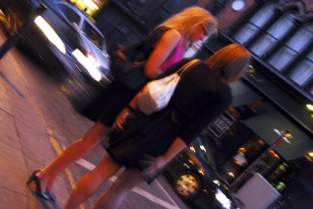 Stock Photo: 4282-25565 Republic of Ireland, Dublin, Temple Bar. Two women enjoying the nightlife of the Temple Bar area in Dublin.