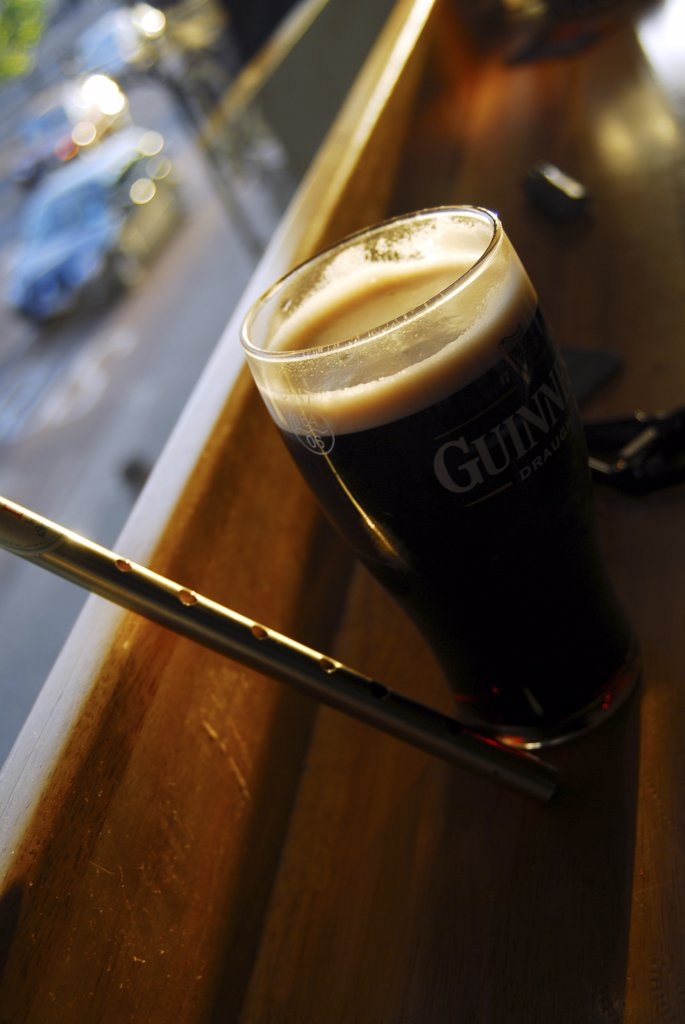 Stock Photo: 4282-25566 Republic of Ireland, Dublin, Temple Bar. Pint of Guinness and tin whistle at a pub in the Temple Bar of Dublin.