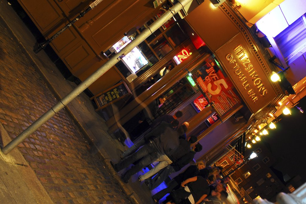 Stock Photo: 4282-25592 Republic of Ireland, Dublin, Temple Bar. Drinkers at night in the busy Temple Bar area of Dublin.