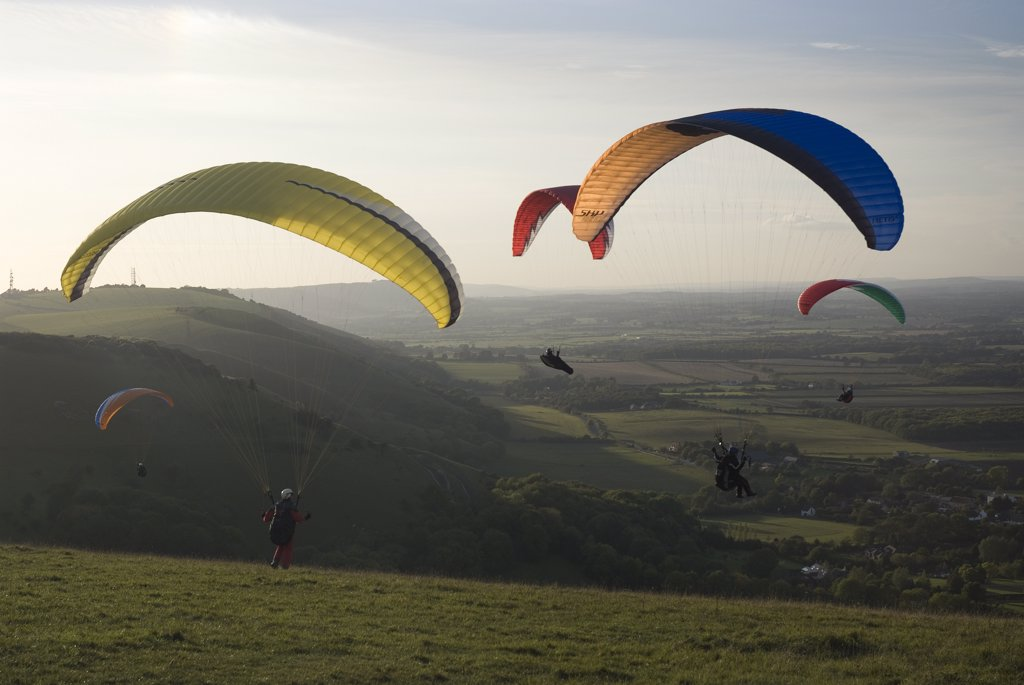 Stock Photo: 4282-25985 England, West Sussex, Devil's Dyke. Paragliders taking off from Devil's Dyke.