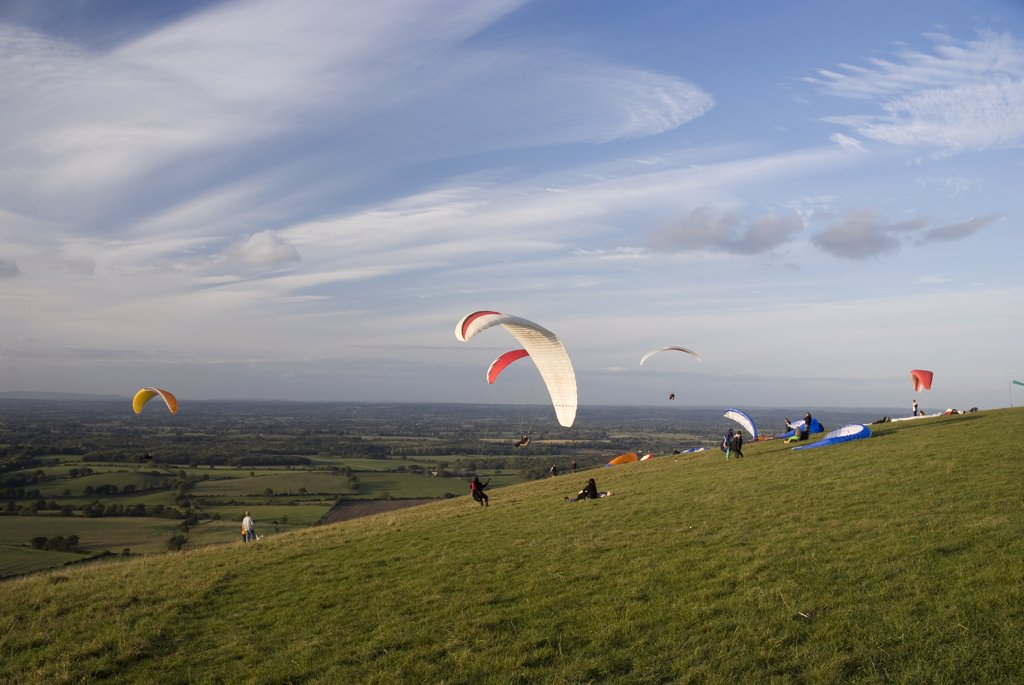 Stock Photo: 4282-25987 England, West Sussex, Devil's Dyke. Paragliders struggling with the wind on Devil's Dyke.