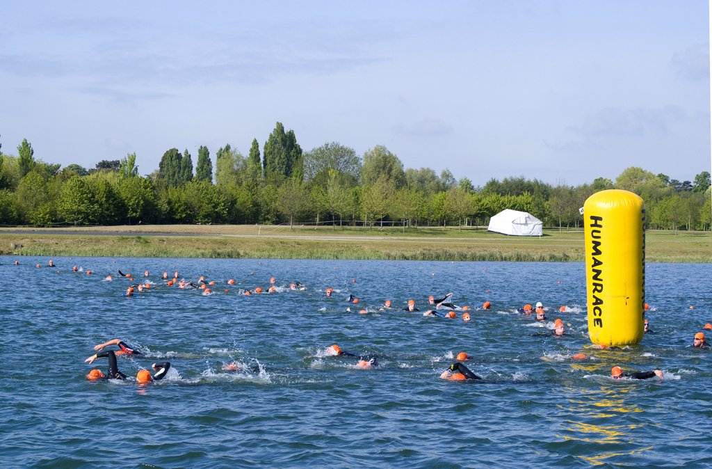 Stock Photo: 4282-26135 England, Berkshire, Windsor. Swimmers rounding a buoy during a Triathlon event at Eton Dorney, the venue for Rowing, Paralympic Rowing and Canoe Sprint events during the London 2012 Games.