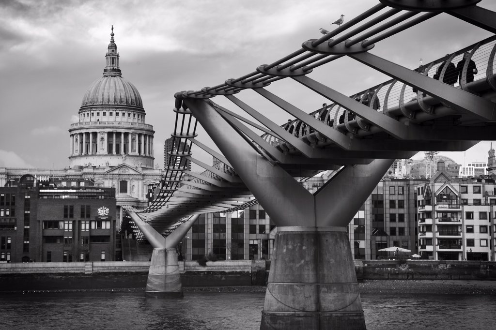 Stock Photo: 4282-26624 England, London, St Pauls. St Paul's Cathedral and the London Millennium Footbridge, crossing the River Thames to link Bankside with the City of London.