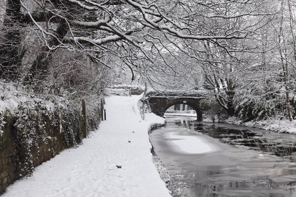 Stock Photo: 4282-26644 England, Lancashire, Saddleworth. A snow covered towpath and sheets of ice on the surface of the Huddersfield Narrow Canal.