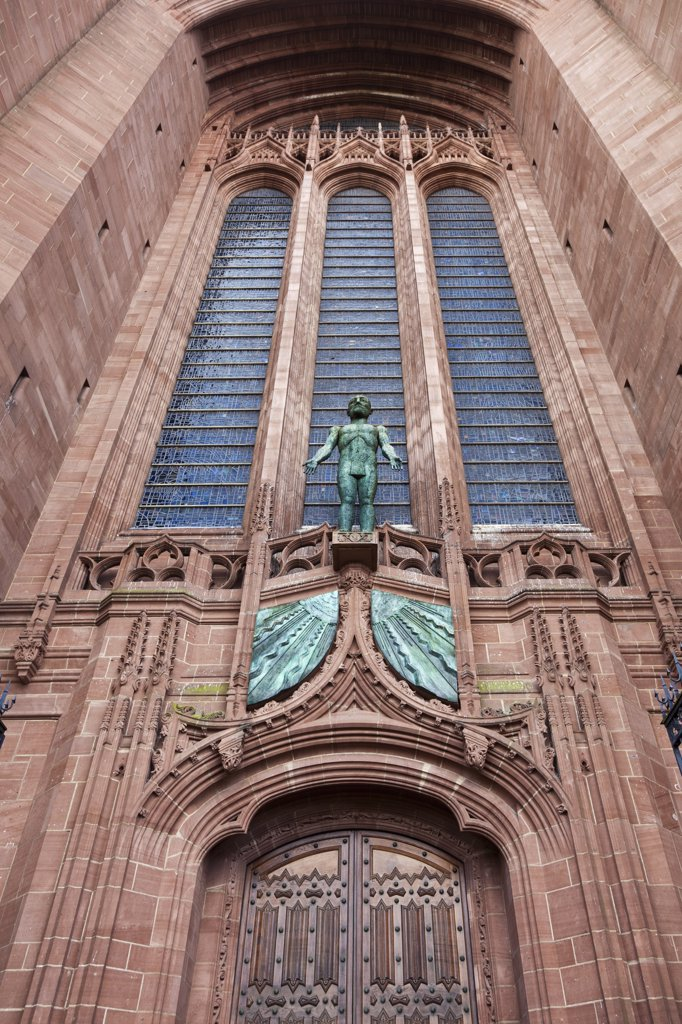 Stock Photo: 4282-26688 England, Merseyside, Liverpool. 'Risen Christ', a statue by Elizabeth Frink above the West door of the Anglican Cathedral.