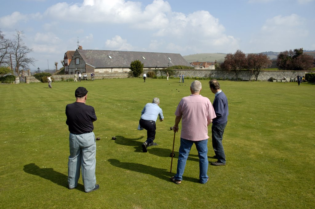 Stock Photo: 4282-27026 England, East Sussex, Lewes. A group of men play bowls on a bowling green in Lewes.