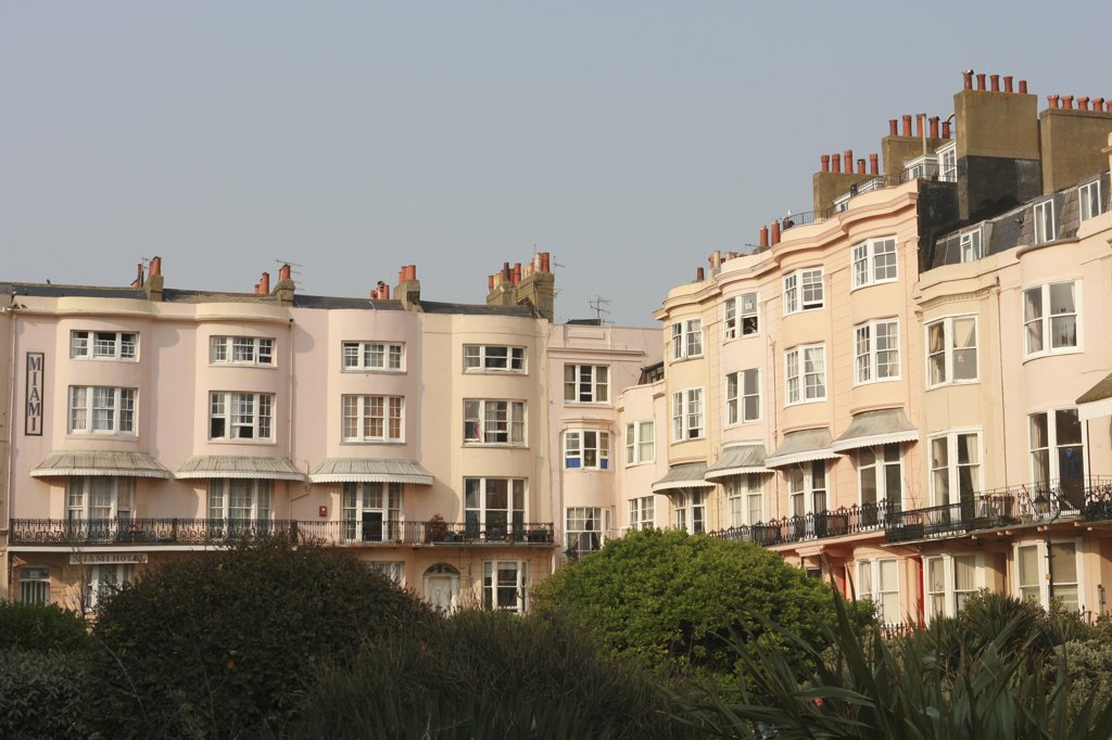 Stock Photo: 4282-27278 England, East Sussex, Brighton. A view of classic pink waterfront apartments in Brighton.