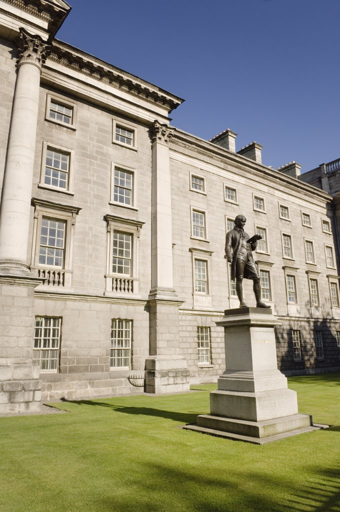 Stock Photo: 4282-27561 Republic of Ireland, Dublin, Dublin. Oliver Goldsmith (1728-1774) statue outside Trinity College. The writer of the play 'She Stoops to Conquer' was born in Co Longford but spent his student years at Trinity College, Dublin.