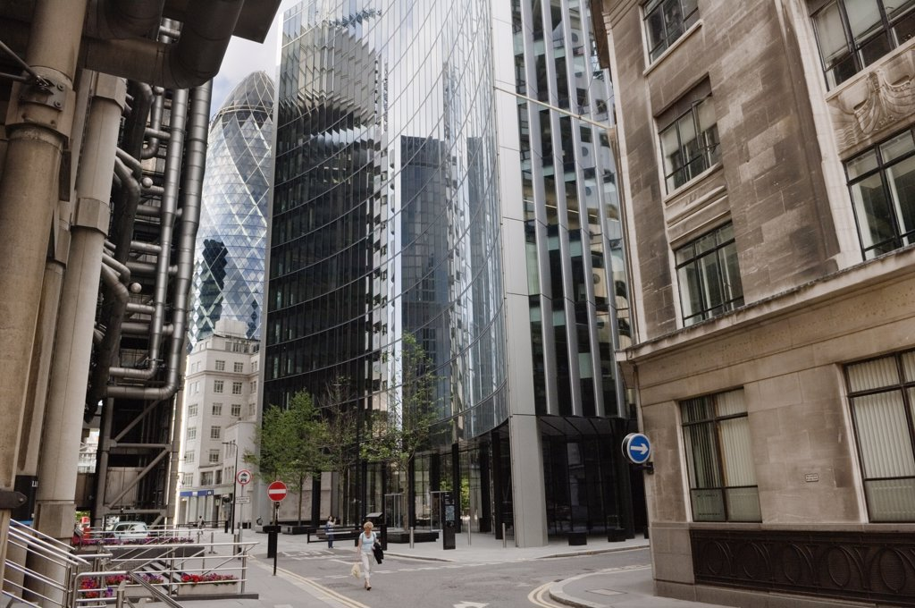 England, London, City of London. View past the Lloyds Building towards The Gherkin (30 St Mary Axe and the Swiss Re Building) in the City of London. : Stock Photo
