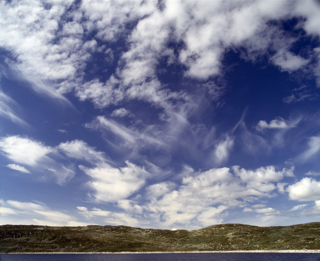 Stock Photo: 4282-27754 Wales, Dyfed, Ceredigion. Cirrus clouds with horizon and sea.  A cirrus cloud is Latin for 'wisp of hair' and is composed of ice crystals and characterised by thin, wisplike strands.