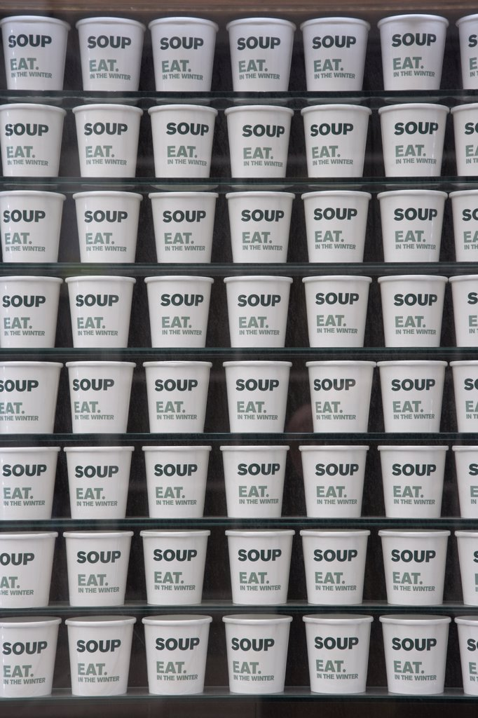 England, London, Shoreditch. A shop window display of stacked soup cartons. : Stock Photo