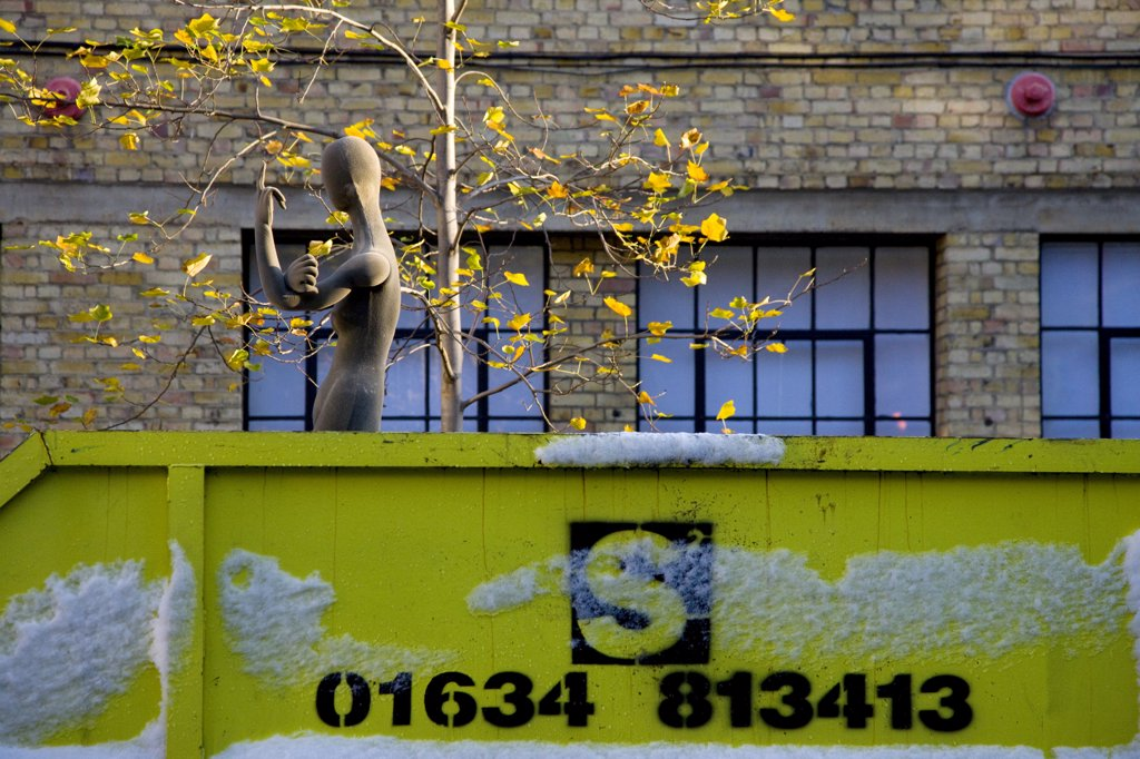 Stock Photo: 4282-28360 England, London, East London. A shop dummy positioned to make a rude gesture in a skip.