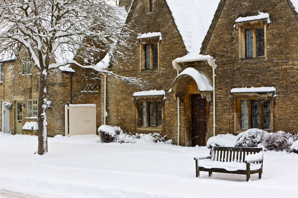 England, Gloucestershire, South Cerney. Snow falling in the Cotswold village of South Cerney. : Stock Photo