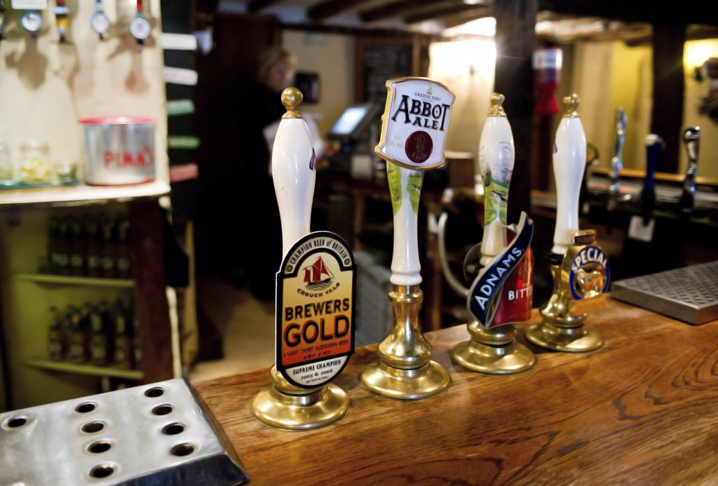 England, Essex, Stock. Beer pump handles on the bar at The Hoop, a freehouse which dates back 450 years. : Stock Photo