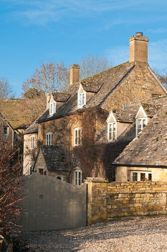 Stock Photo: 4282-28968 England, Gloucestershire, Naunton. Cotswold Stone Cottages in the village of Naunton.