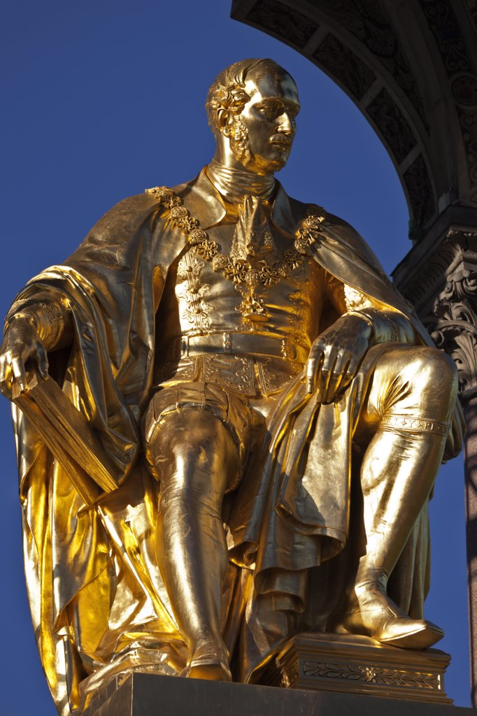 Stock Photo: 4282-29004 England, London, South Kensington. Statue of Prince Albert seated in the centre of the Albert Memorial. The memorial was commissioned by Queen Victoria in memory of her husband. It was designed by Sir George Gilbert Scott and opened in 1872.