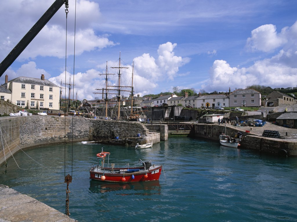 Stock Photo: 4282-29108 England, Cornwall, Charlestown. Charlestown is a famous film and television location (Poldark, etc.) built 1793-1801 for local industrialist Charles Rashleigh. The dock is still used to export China clay and refit tall ships. Two small local fishing boats known as 'toshes' are moored in the outer harbour.